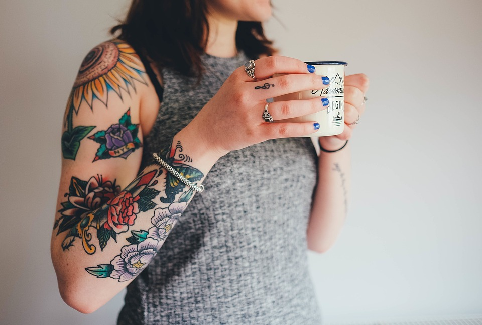 tattoos tattooing arm skin flower tattoos woman hands jewelry bracelet rings colorful female girl caucasian bright brunette lifestyle portrait body style fashion person tattoos tattoos tattoos tattoos tattoos jewelry bracelet bracelet