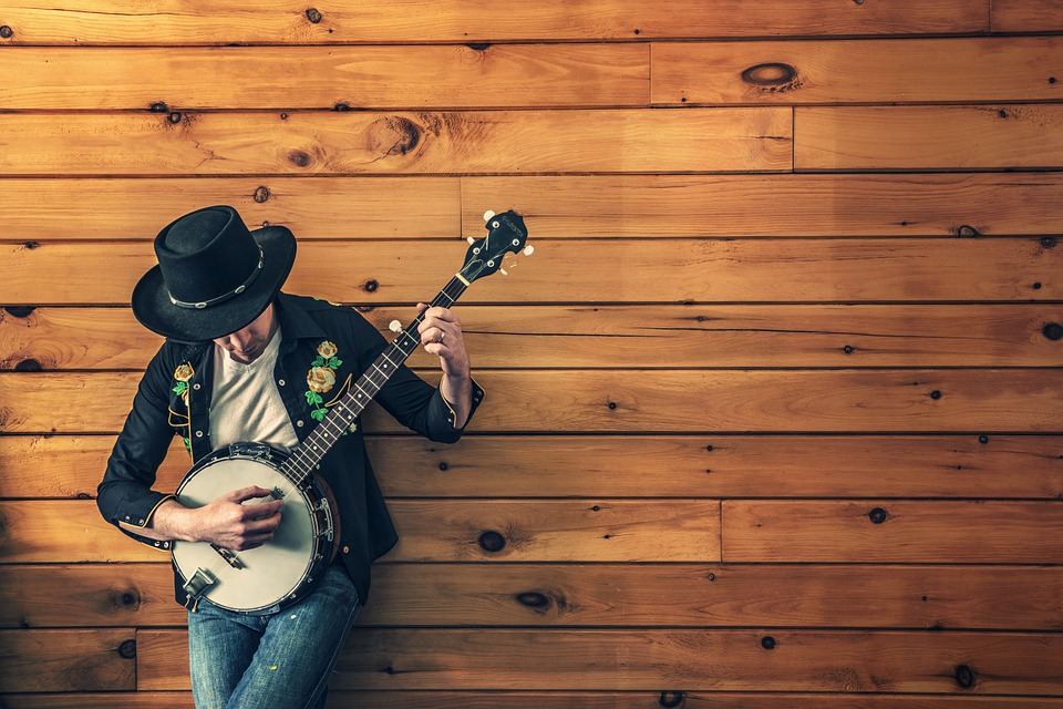 musician country song banjo ukulele guitar acoustic guitar musical instrument instrument music wood classic musical guitarist people jeans hat paneling musician guitar music music music music music